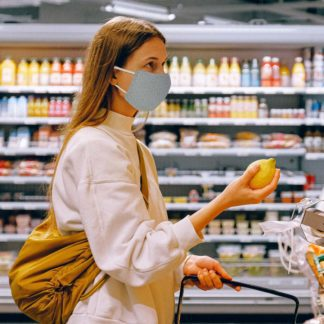Woman grocery shopping wearing Kinder PPE Mask